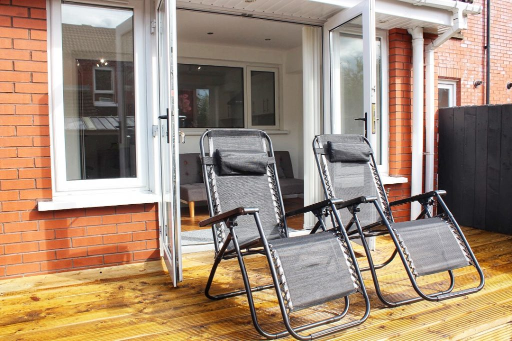 garden with lounge chairs